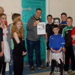 Mrs Butler and the Sixth Class students with Ethan Hynes